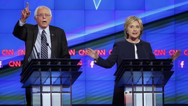 Clinton y Sanders acaparan la atención en el primer debate demócrata