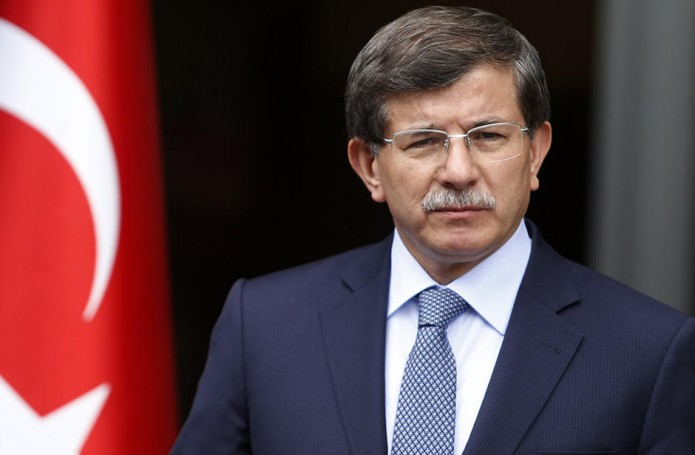 File photo shows Turkey's Foreign Minister Davutoglu addressing the media in Ankara