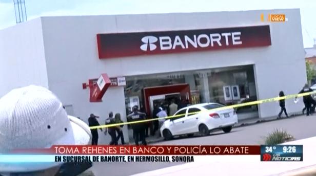 De película. Un asaltante mantuvo como rehenes a cuatro mujeres adentro de un banco. Fue abatido